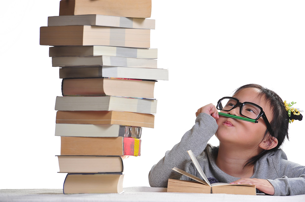 asian girl w.book stack.jpg