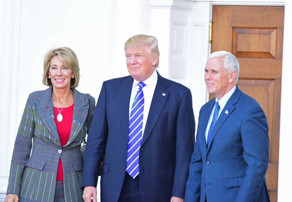 Betsy Devos, Donald Trump, and Mike Pence at Trump National Golf Club in Bedminster, NJ
